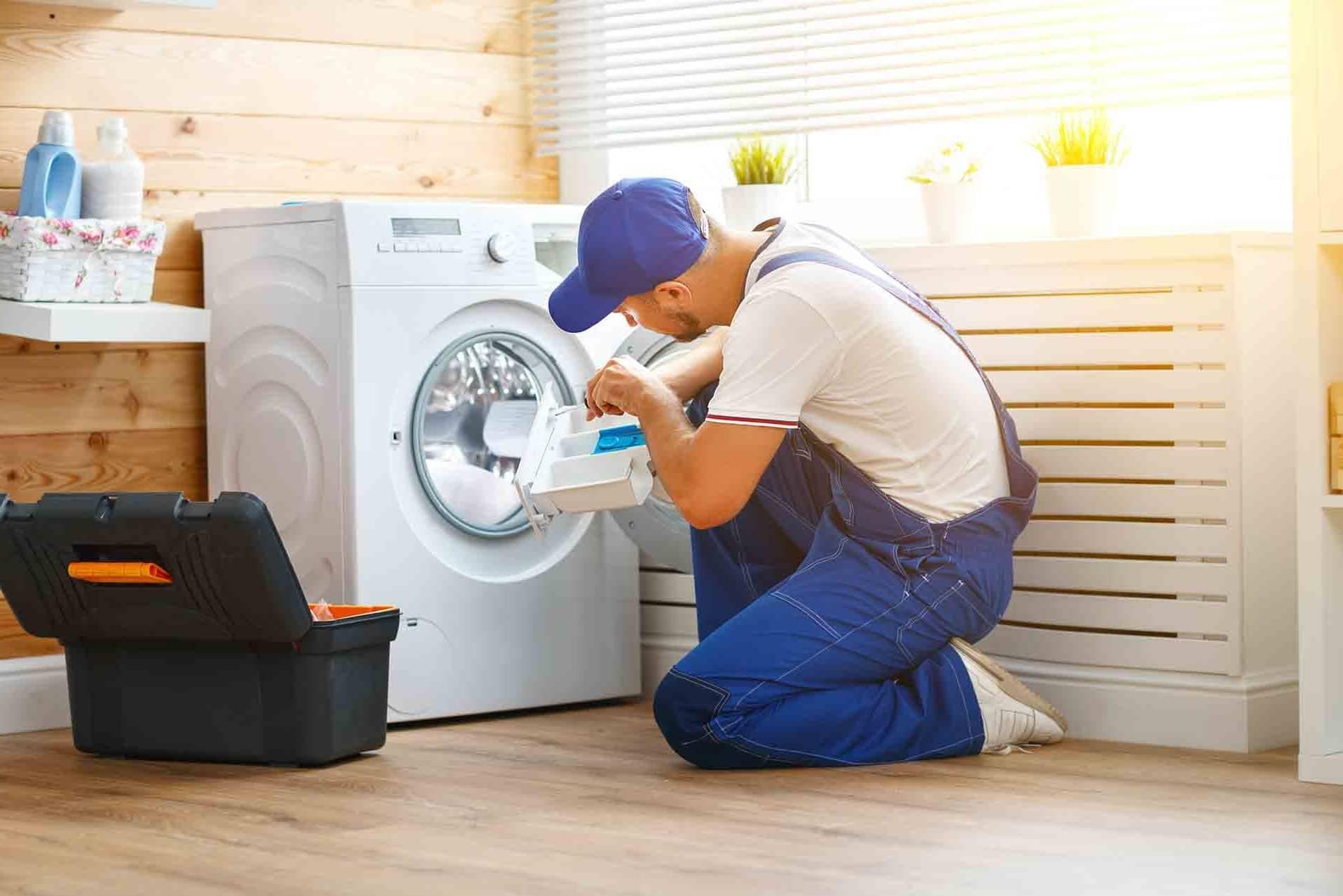 engineer-repairing-washing-machine